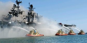 احتمال تداوم چندروزه آتشسوزی در کشتی جنگی آمریکا