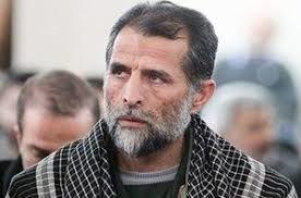 تصویری ماندگار از وداع یک سردار با یک شهید مدافع حرم